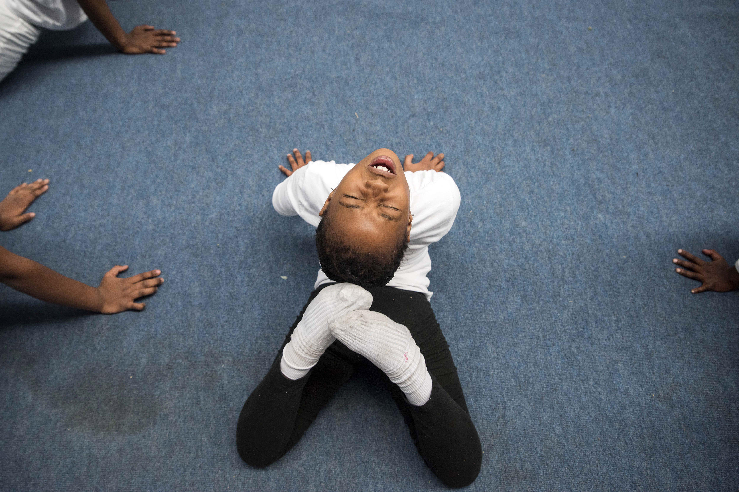 July 26, 2018: Mbali Bob pushes herself during warm-up, which includes stretching.