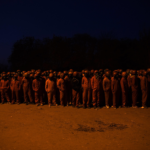 6 June 2017: Before dawn the Red Ants await their orders before departing on an operation in the city centre. Red Ants compound, South of Johannesburg.