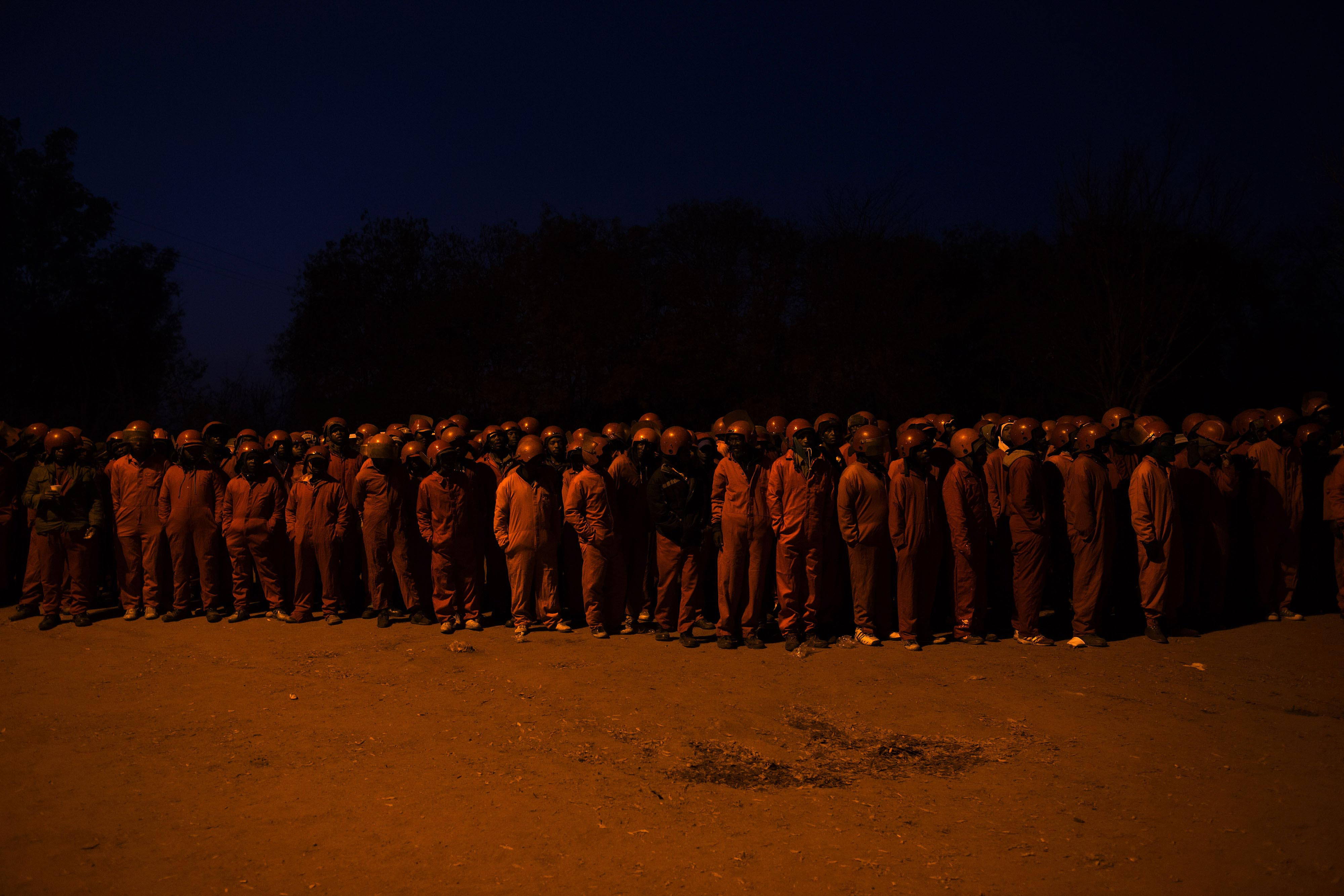 6 June 2017. Before dawn the Red Ants await their orders before departing on an operation in the city centre. Red Ants compound, South of Johannesburg.