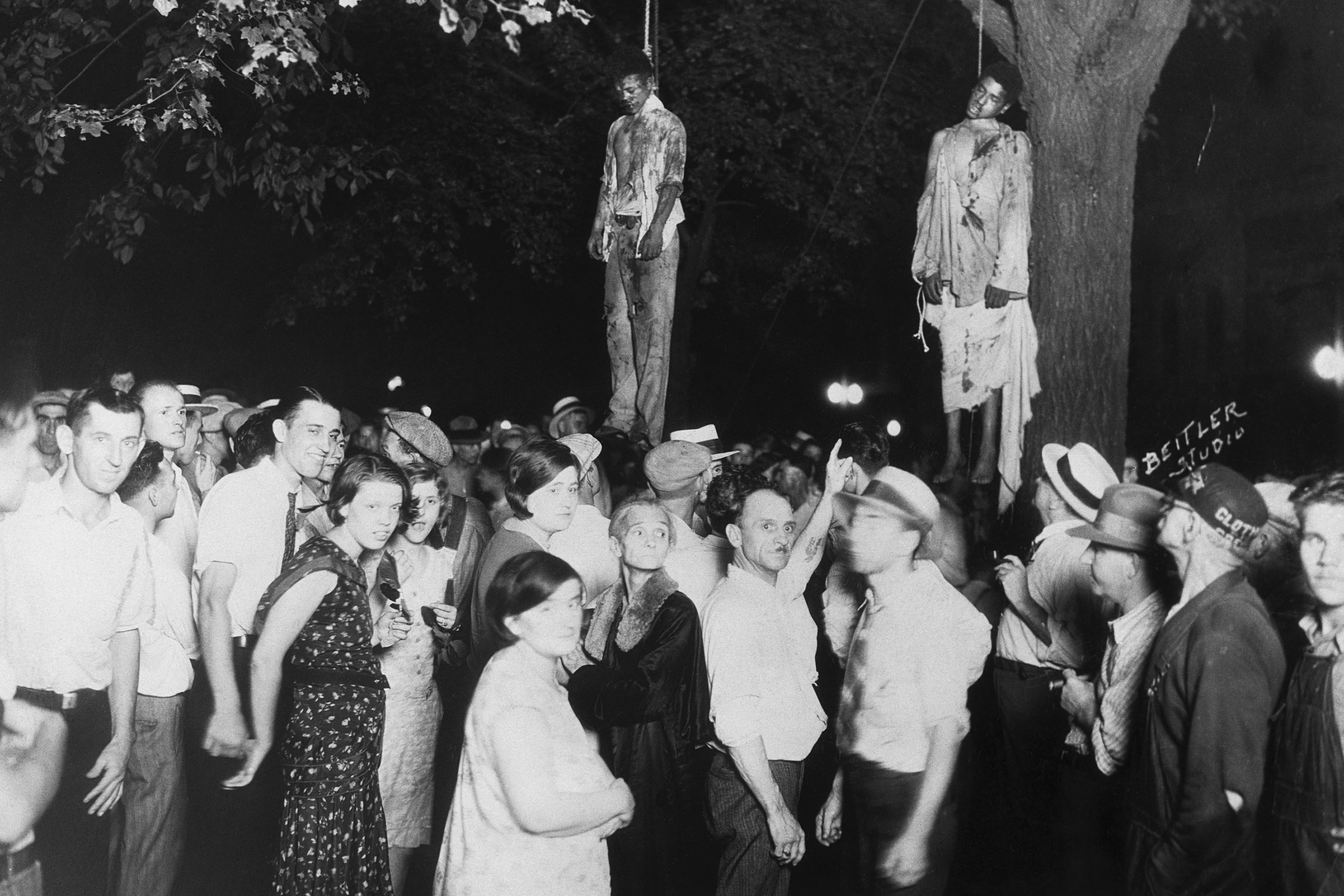 7 August 1930: After being accused of murdering Claude Deeter and raping his girlfriend Mary Ball, Thomas Shipp and Abram Smith were taken from the Grand County Jail and publicly lynched. (Photographed by Lawrence Beitler)