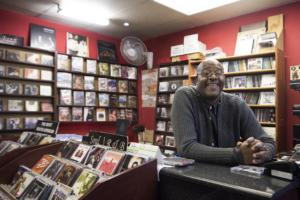 Bra Eddie behind the counter of Just CD's in Johannesburg