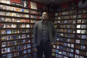 Bra Eddie standing in front of CD racks in Just CD's