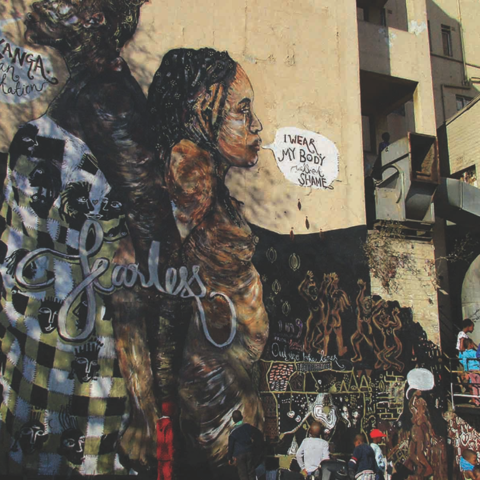 2016: OneinNine paints a mural, I wear my body without shame, with members of India's Fearless Collective and HOLAA Africa, on the wall of the Florence Building in Hillbrow. (Photograph courtesy of: Judy Seidman/OneinNine)