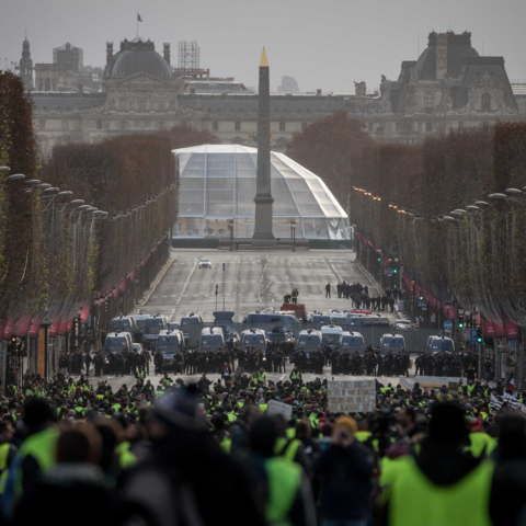 8 December 2018: Protesters walk towards a police line on the Champs-Elysées during the 'yellow vests' demonstration in Paris, France. (Photograph by Chris McGrath/Getty Images)