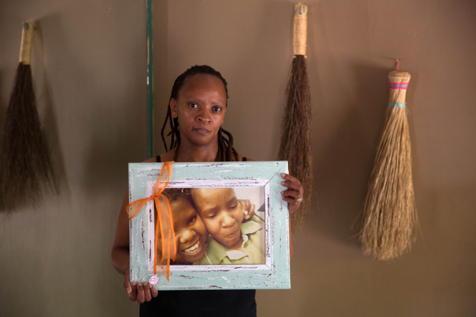 2 October 2018: Christine Nxumalo holds a portrait of her sister Virginia Machpelah, one of the victims of Life Esidimeni, and her niece Shanice Machpelah, who died on the first day of the hearings into the spiral of abuse.