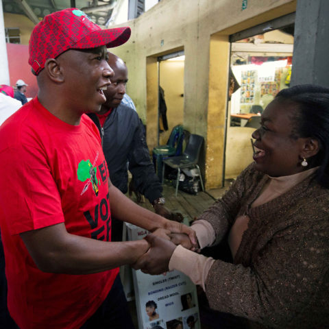 17 April 2019: EFF leader Julius Malema greets a woman in a Pietermaritzburg taxi rank during an election campaign walkabout ahead of the general election on 8 May. (Photograph by Reuters/Rogan Ward)