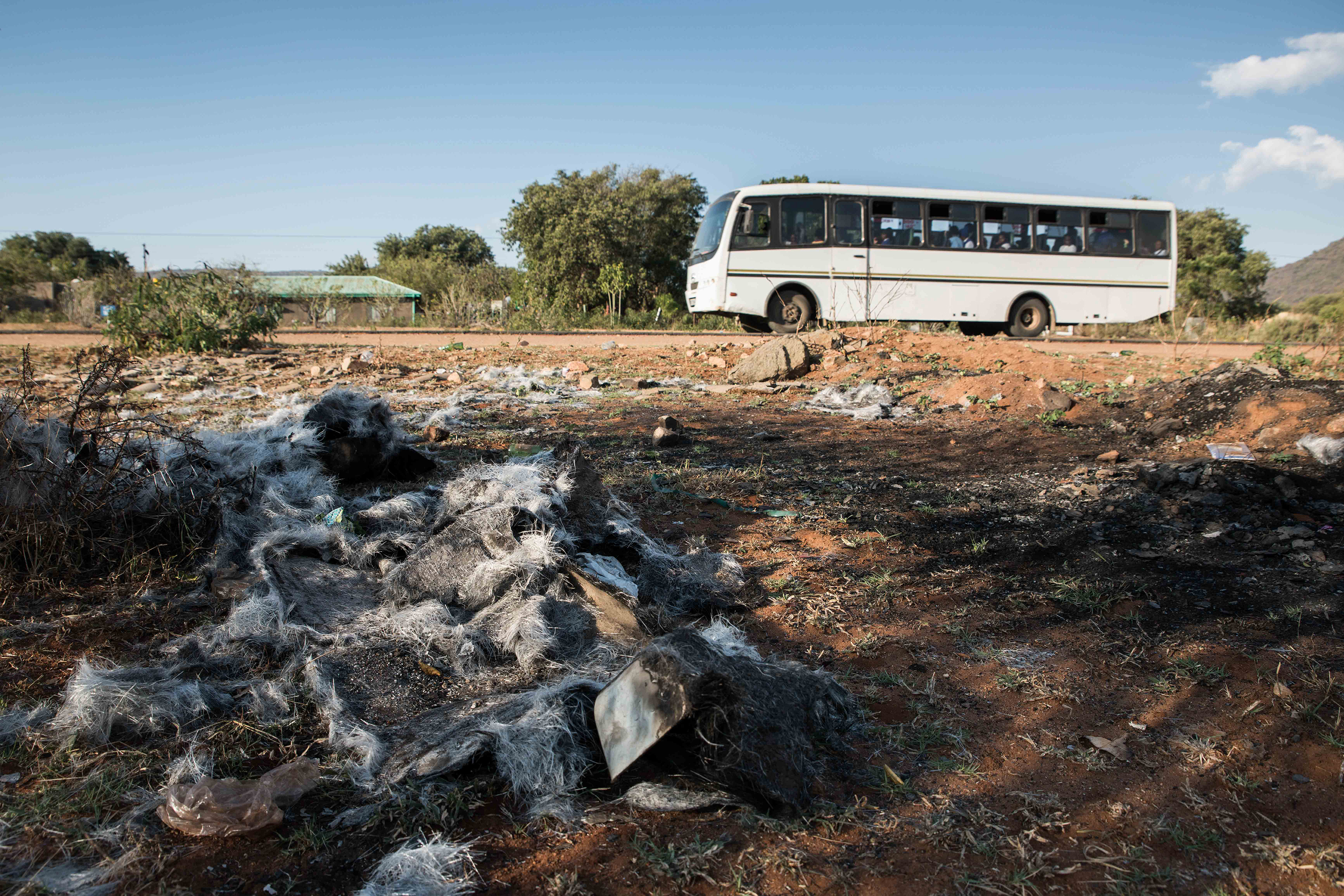 12 May 2018: Buses pass close to where on 2 April 2018, a bus transporting miners to Modikwa Platinum Mine, outside Burgersfort was set alight with a petrol bomb.