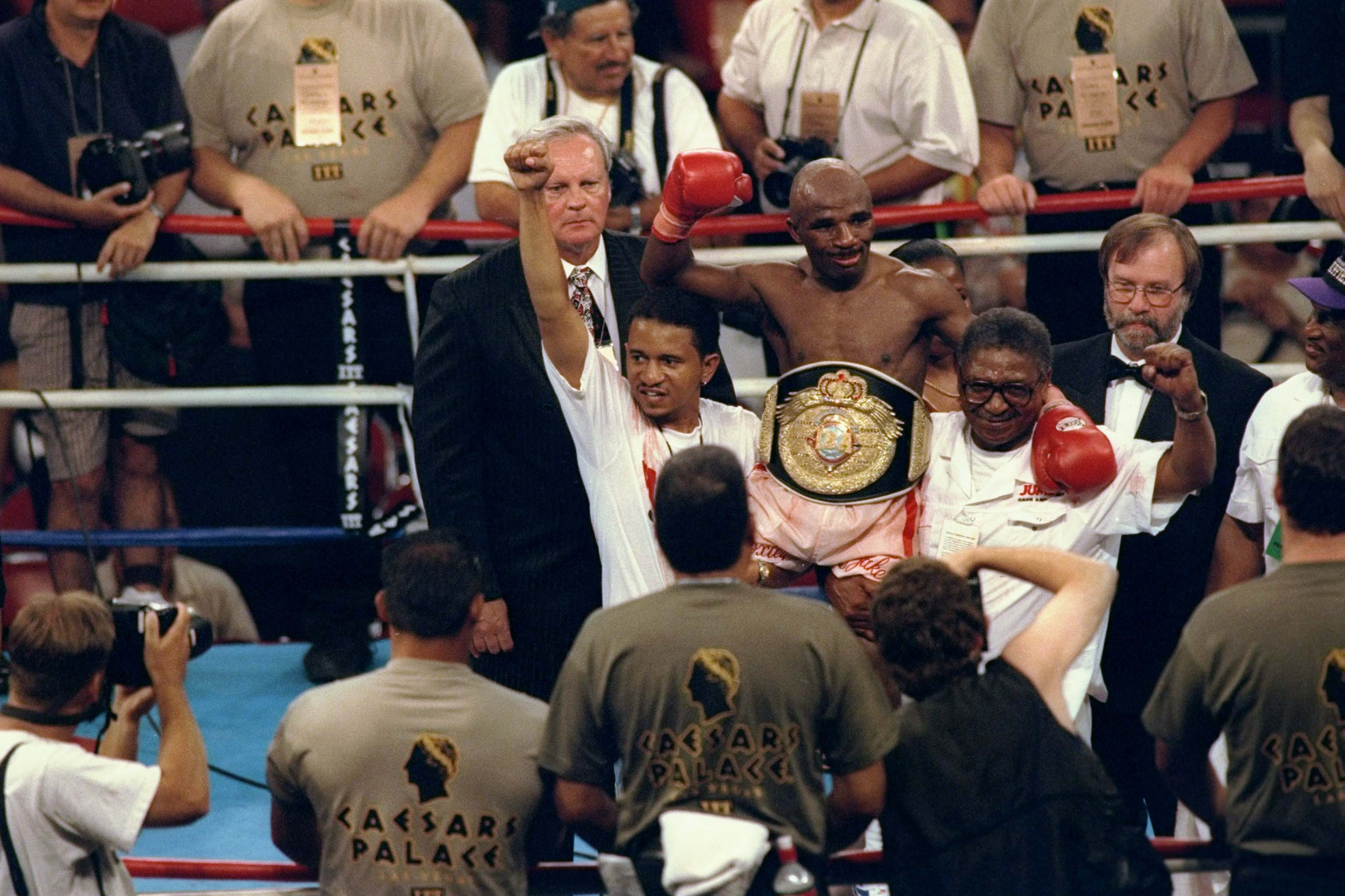 "18 July 1997: Jacob ""Baby Jake"" Matlala of South Africa celebrates his win over Michael Carbajal in Las Vegas. Boxing South Africa, despite problems, is confident it can return the sport to glory. (Photograph by Harry How/Allsport)"