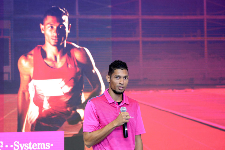 28 February 2019: Wayde van Niekerk the man stands in front of a giant photograph of Wayde van Niekerk the athlete during a T-Systems event to publicise the IT firm renewing its sponsorship of Van Niekerk. (Photograph by Lee Warren/Gallo Images)