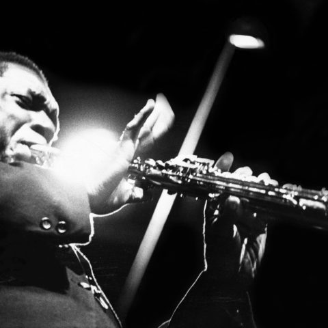 1965: John Coltrane performs on stage at the Half Note club in New York. (Photograph by Adam Ritchie/Redferns)