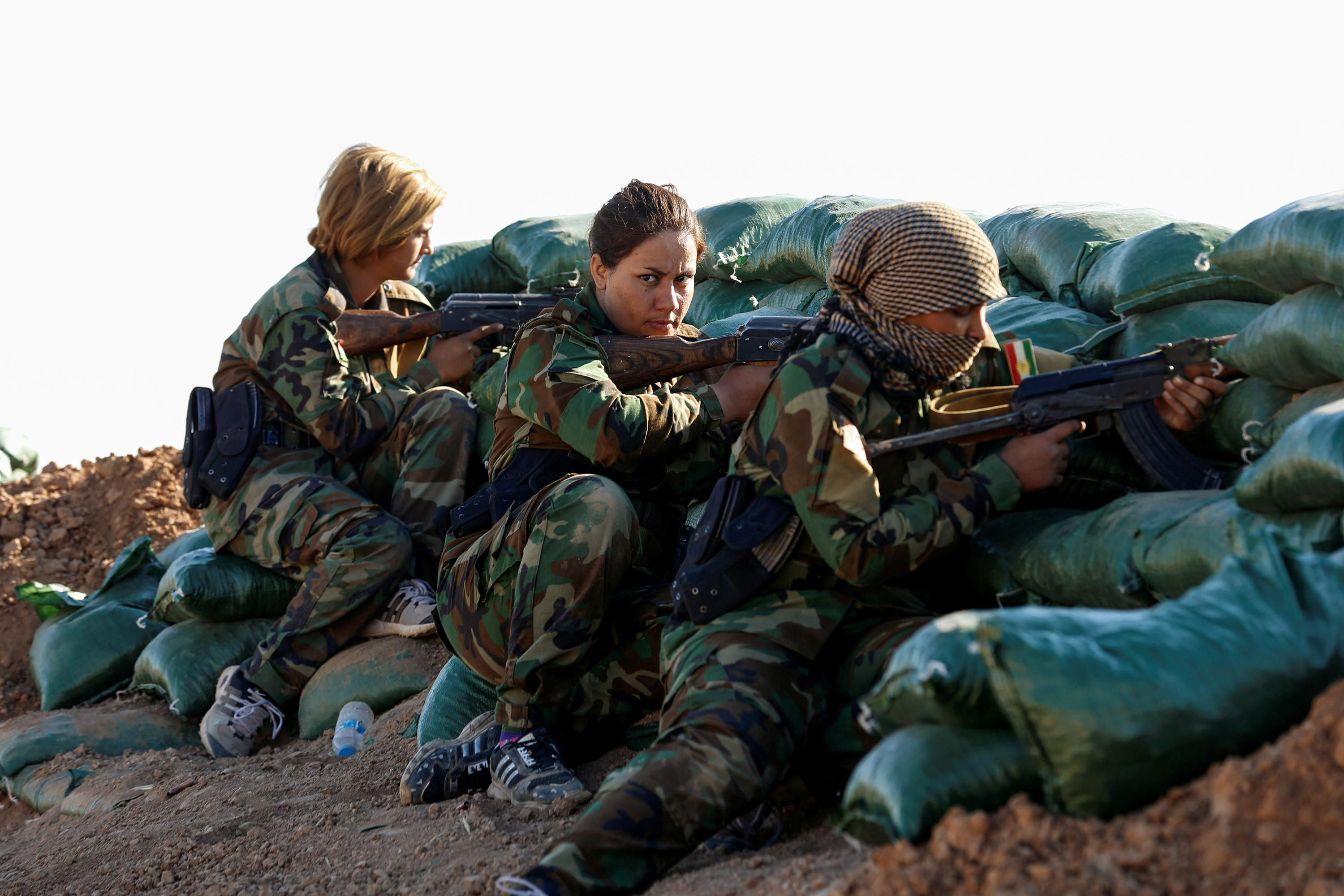 3 November 2016: Iranian-Kurdish female fighters take position during a battle with the Islamic State in Bashiqa, near Mosul, Iraq. (Photograph by Ahmed Jadallah/Reuters)