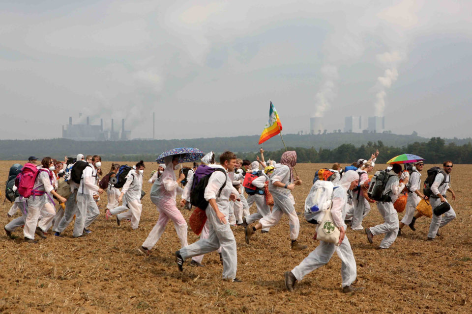26 August 2017: Protesters opposing open-pit coal mines in the Rhineland region near Bedburg, Germany. Protesters, seeking to bring attention to the impact of coal on climate change, converged on the region for two days of disruptive disobedience. (Photo