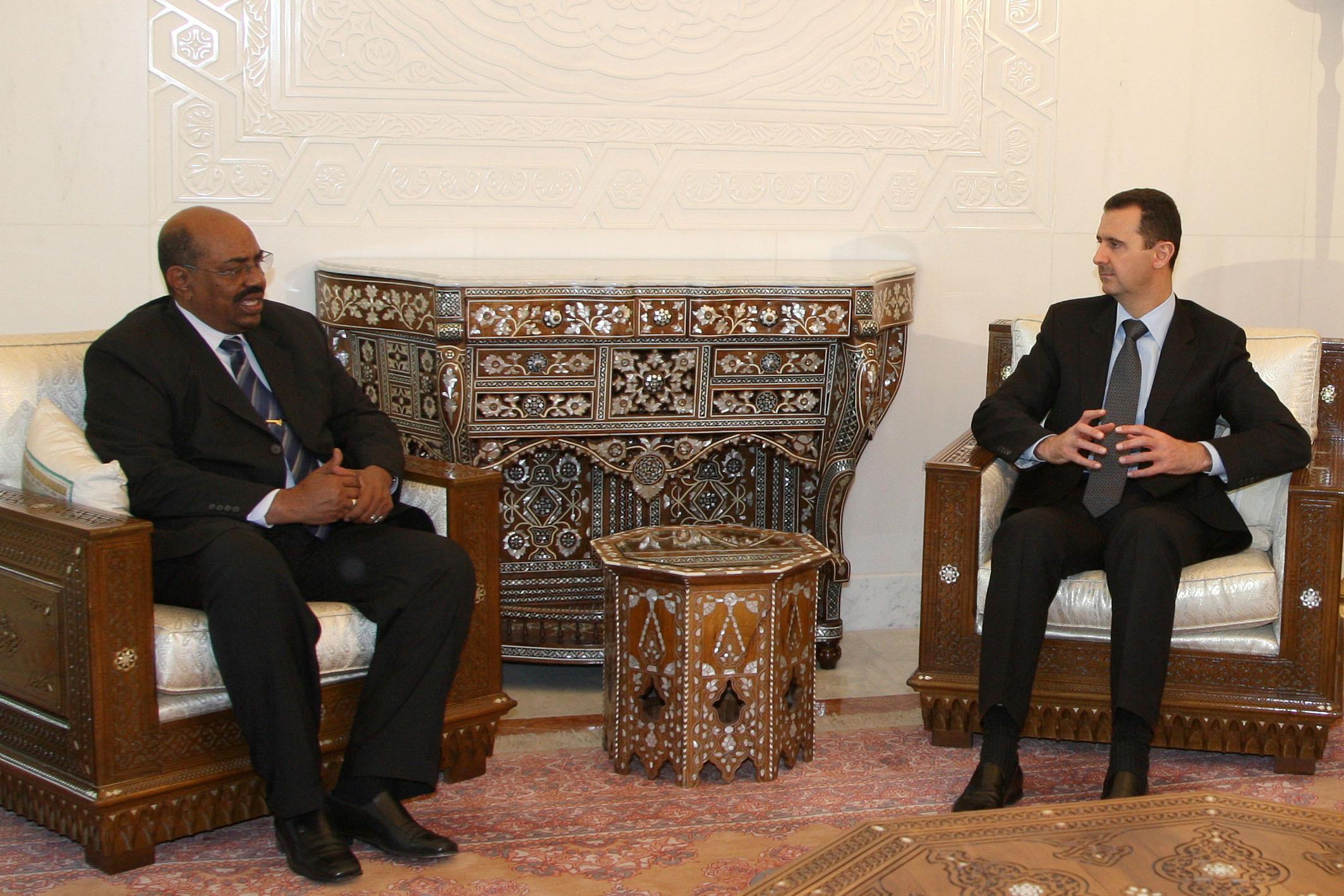12 January 2009: Syrian President Bashar al-Assad (right) meets Sudanese President Omar al-Bashir in Damascus, Syria. (Photograph by Reuters/Khaled al-Hariri)