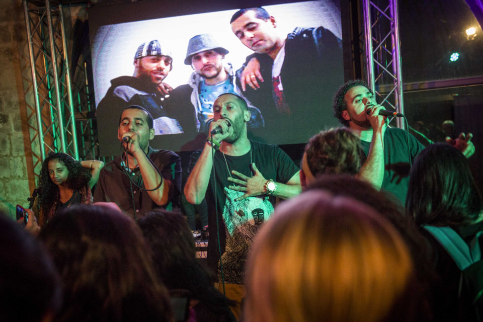 4 June 2014: Palestinian hip-hop group DAM performing at the Palestine Festival of Literature at Qasr al Qassem in Beit Wazan, near Nablus, West Bank. (Photograph by Rob Stothard/Getty Images)