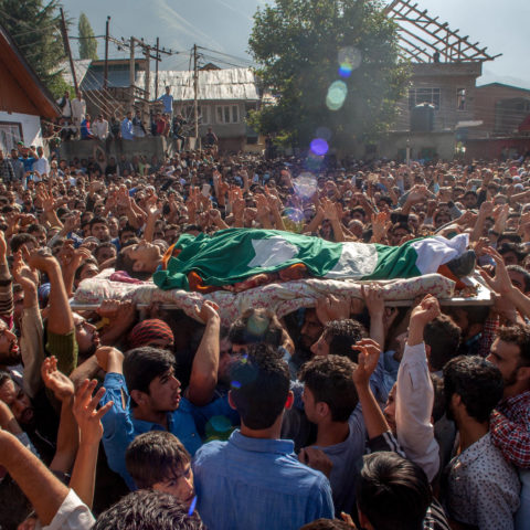 17 September 2016: Kashmiri Muslims carry the body of Nasir Shafi, an 11-year-old killed by Indian government forces, during his funeral in Srinagar, Kashmir. (Photograph by: Yawar Nazir/Getty Images)