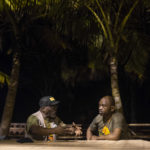 20 September 2018: Abahlali baseMjondolo activist S'bu Zikode (right) in conversation with American activist Willie Baptist (left) at Winneba Beach in Ghana.