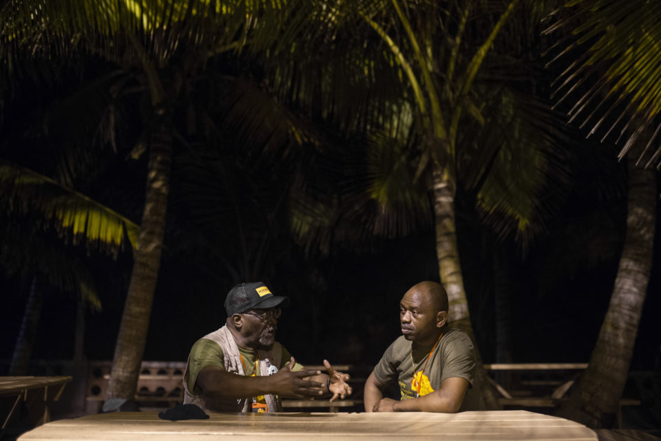 20 September 2018: Abahlali baseMjondolo activist S'bu Zikode (right) in conversation with American activist Willie Baptist (left) at Winneba Beach in Ghana.