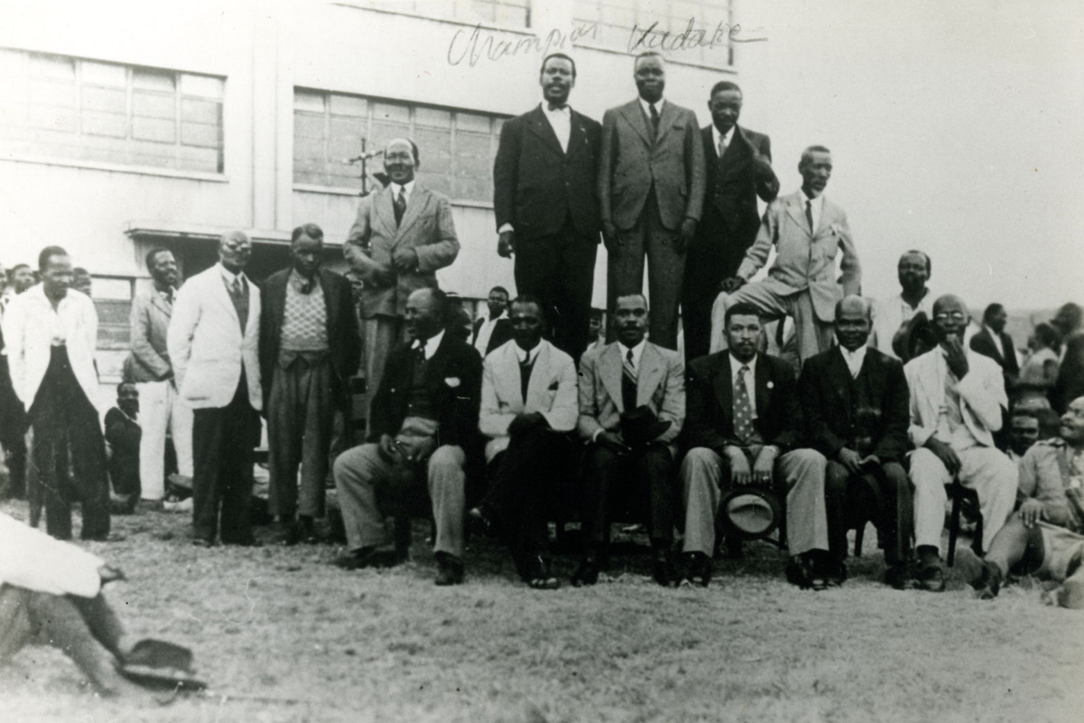(L-R) Allison Champion and Clements Kadalie (standing, with handwritten names above), along with other ICU members, in this undated photograph from the 1920's. (Photograph courtesy of UKZN Campbell Collection)