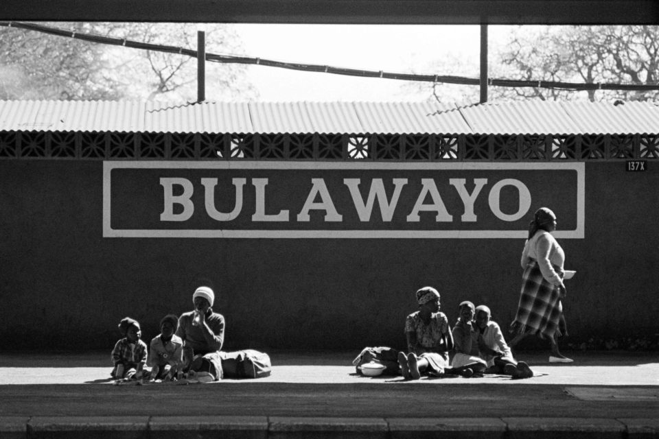 Women and children waiting for a train at Bulawayo station, Zimbabwe in this photograph from 1985. (Photograph by Dario Mitidieri/Getty Images)