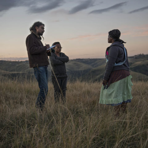 26 June 2013: Journalist Niren Tolsi (left) interviewing Nocingile Sokanyile (right), the widow of Phumzile Sokanyile, a striking mineworker who was killed at Marikana by police in 2012. (Photograph by Paul Botes)