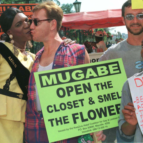 29 August 1998: Activists demonstrate against former Zimbabwean President Robert Mugabe's policy's towards homosexuality demonstrate outside the Non-Aligned Movement Summit in Durban. (Photograph by Juda Ngwenya)