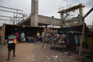 31 October 2018: The construction of a massive mall overlooks the tiny spaces used by the street traders of Denneboom in Mamelodi after their stalls were destroyed to make space for the mall.
