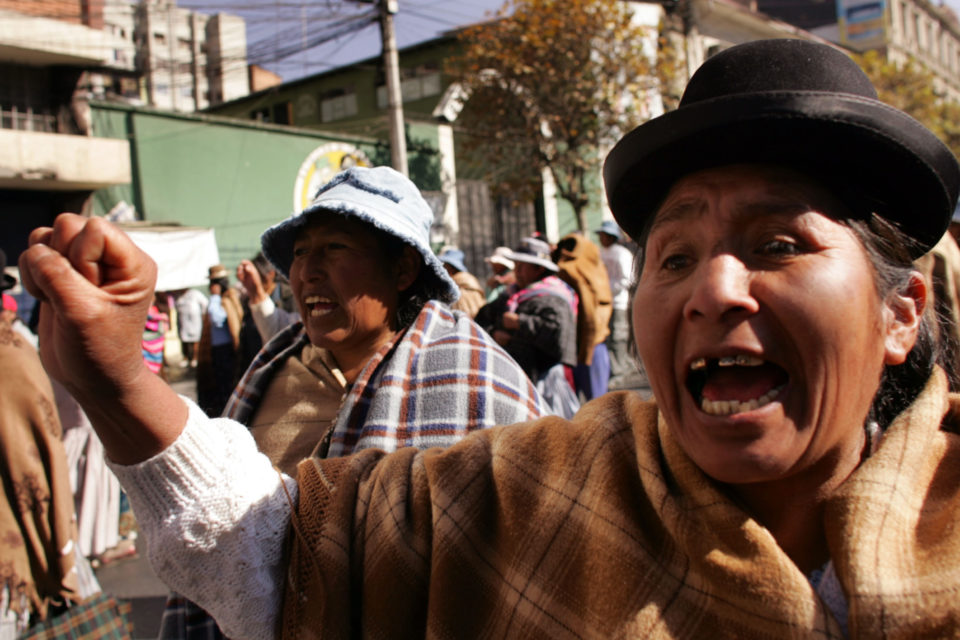31 May 2005: Women march through the streets of La Paz, Bolivia, to demand the resignation of President Carlos Mesa and force the government to nationalise Bolivia's gas reserves. (Photograph by Spencer Platt/Getty Images)