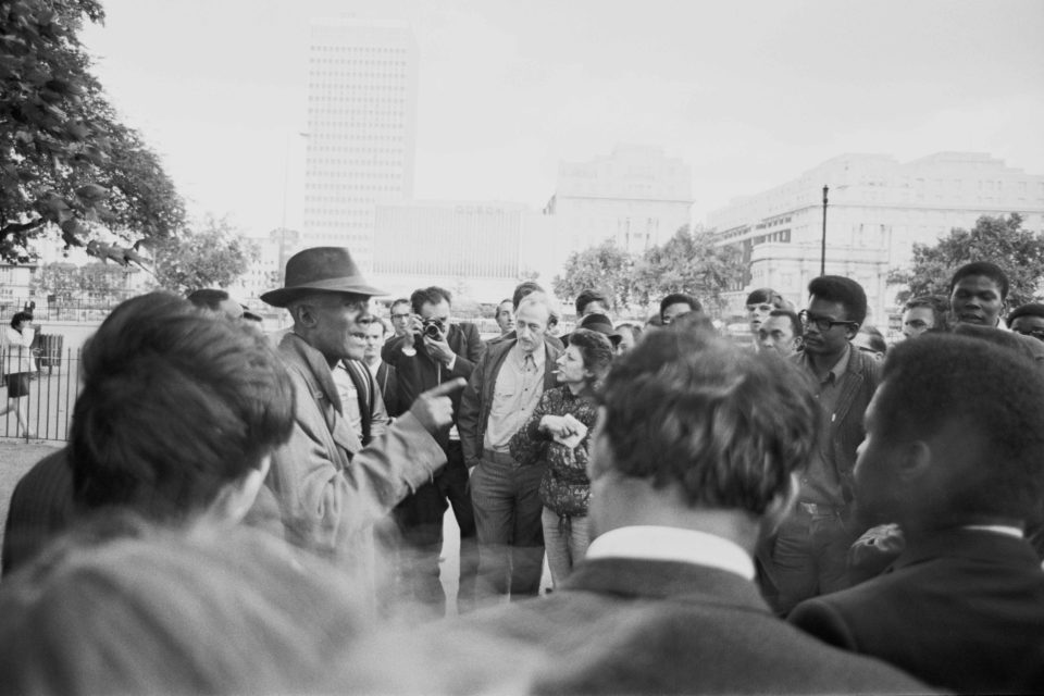 18 August 1967: Trinidadian socialist Cyril Lionel Robert James talking to a group of students during a rally organised by the West Indian Students Union at Speakers' Corner, London. (Photograph by Roy Milligan/Daily Express/Getty Images)