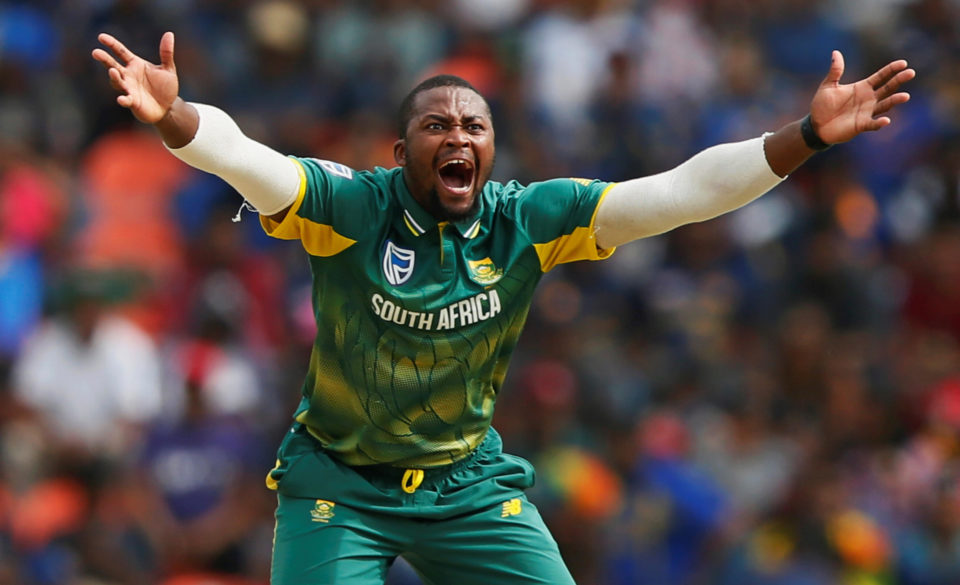 South Africa's Andile Phehlukwayo celebrates after taking the wicket of Sri Lanka's Kusal Perera. REUTERS/Dinuka Liyanawatte