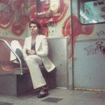 John Travolta sits in a subway car in a scene from 'Saturday Night Fever', the 1977 smash-hit disco film. (Photograph by Paramount Pictures/Getty Images)