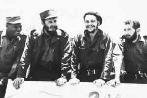 """22 August 1960: Ernesto """"Che"""" Guevara, second from right, with Cuban leader Fidel Castro, second from left, reviewing a peasant militia parade at the San Julian Base in Cuba. (Photograph by Bettmann/Contributor)"""