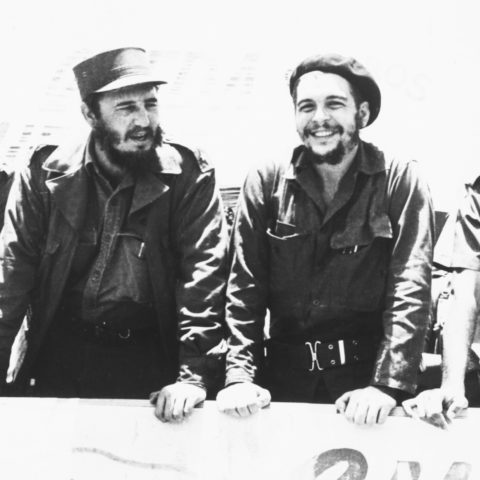 "22 August 1960: Ernesto ""Che"" Guevara, second from right, with Cuban leader Fidel Castro, second from left, reviewing a peasant militia parade at the San Julian Base in Cuba. (Photograph by Bettmann/Contributor)"