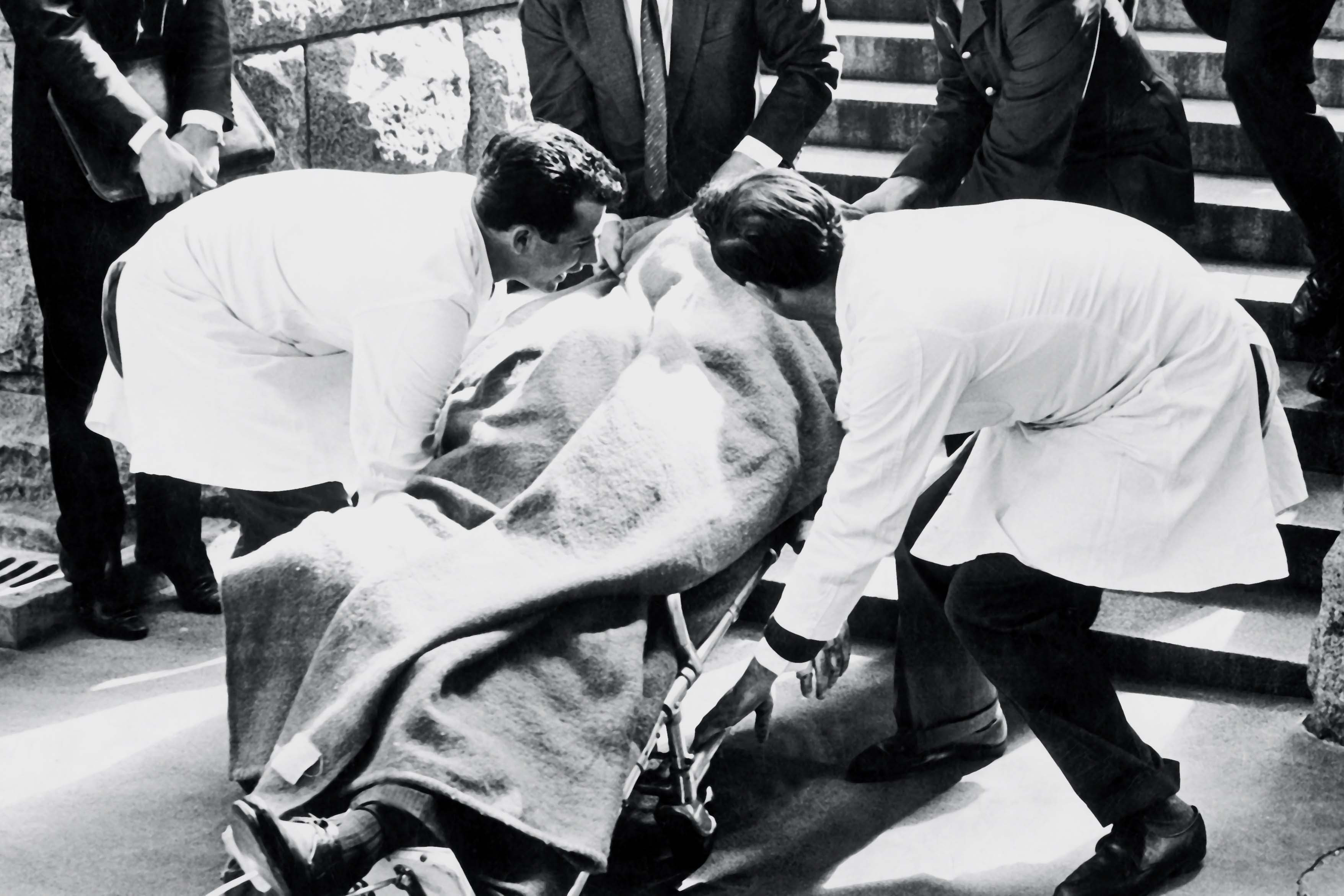 6 September 1966: The body of Hendrik Verwoerd, leader of the National Party and South African prime minister from 1958 to 1966, is carried out of Parliament after he was assassinated by Dimitri Tsafendas. (Photograph by Die Burger/Media24)