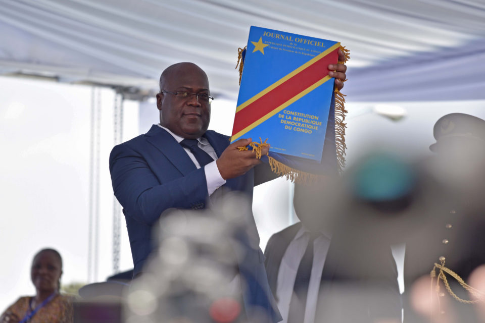 24 January 2019: Félix Tshisekedi holds up the Constitution during his inauguration ceremony as the new president of the Democratic Republic of the Congo, which took place at the Palais de la Nation in Kinshasa. (Photograph by Reuters/Olivia Acland)