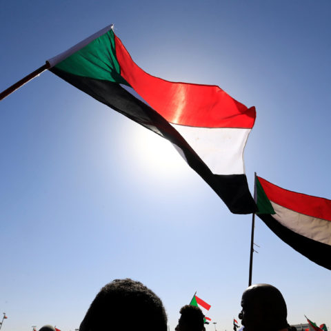 9 January 2019: Supporters of Sudan's President Omar al-Bashir wave national flags as they chant slogans in his favour during a rally at the Green Square in Khartoum, Sudan. (Photograph by Mohamed Nureldin Abdallah/Reuters)