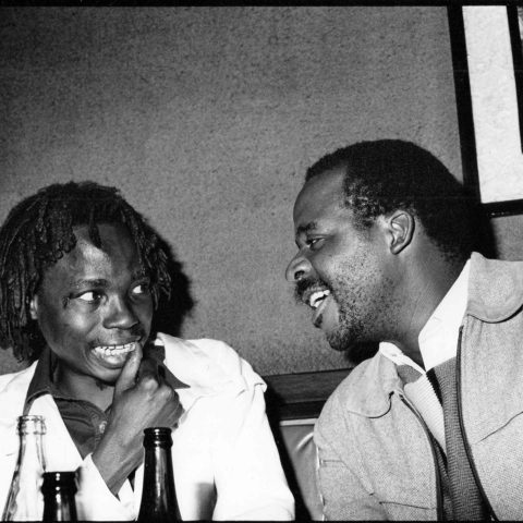 May 1987: Dambudzo Marechera (left) and Charles Mungoshi in conversation in Harare, Zimbabwe. (Photograph by Ernst Schade/Humboldt University of Berlin)