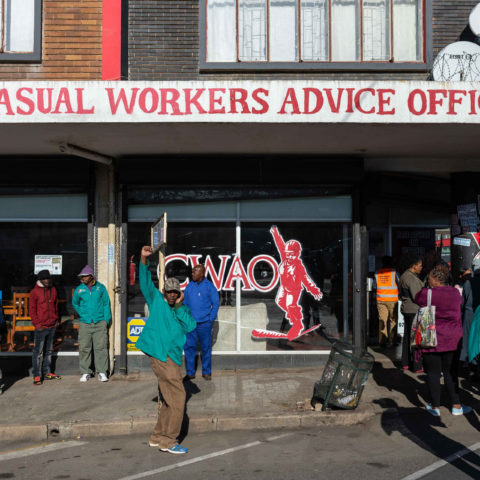 Gathering outside the Casual Workers Advice Office in Germiston, members of the Simunye Workers Forum were joined by other causal workers organisations as they get ready to march to the Ekurhuleni municipality.