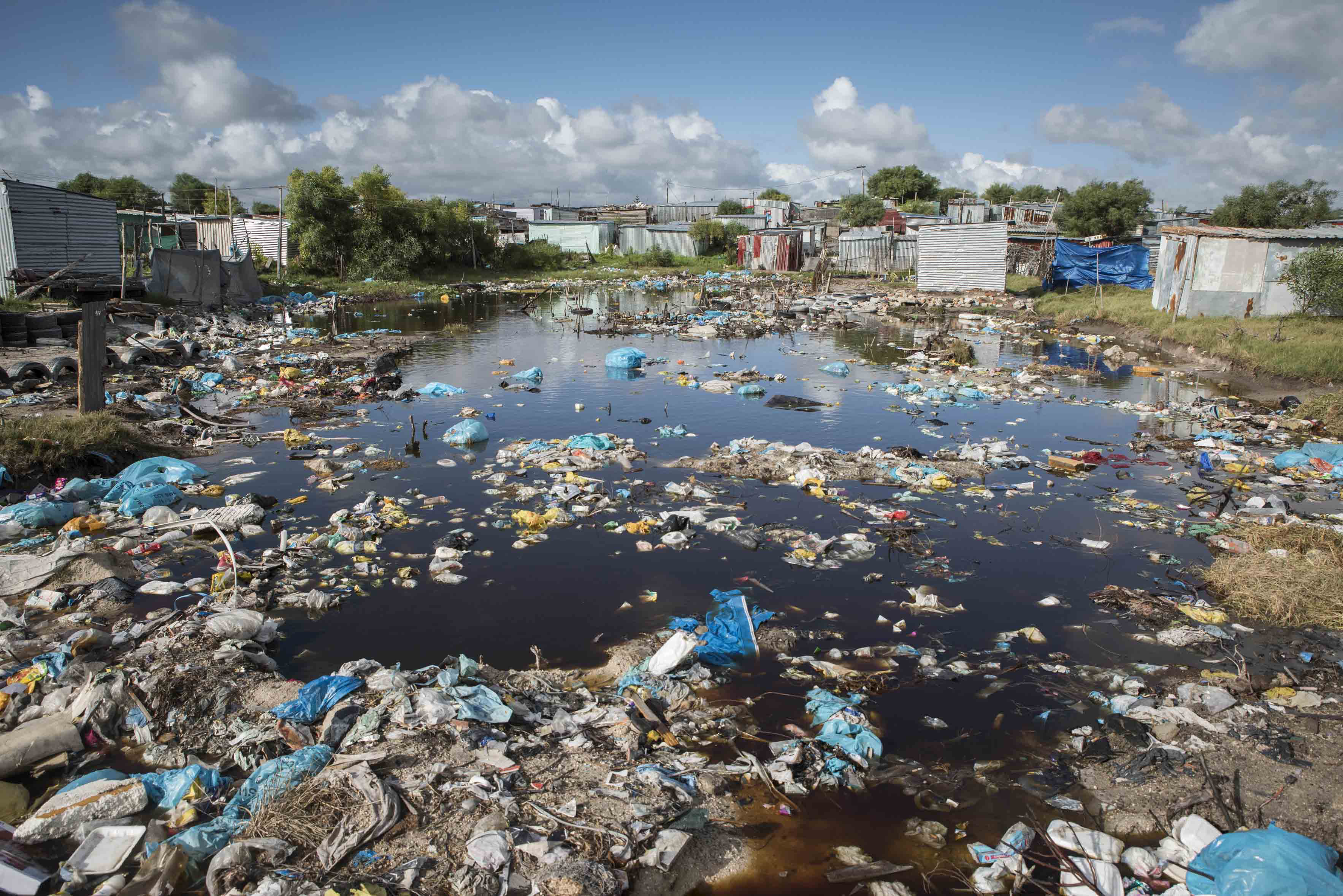 26 April 2018: Heavy rains and poor drainage result in a large pool of heavily polluted stagnant water. Much of the Marikana settlement is under the water table resulting in regular flooding.