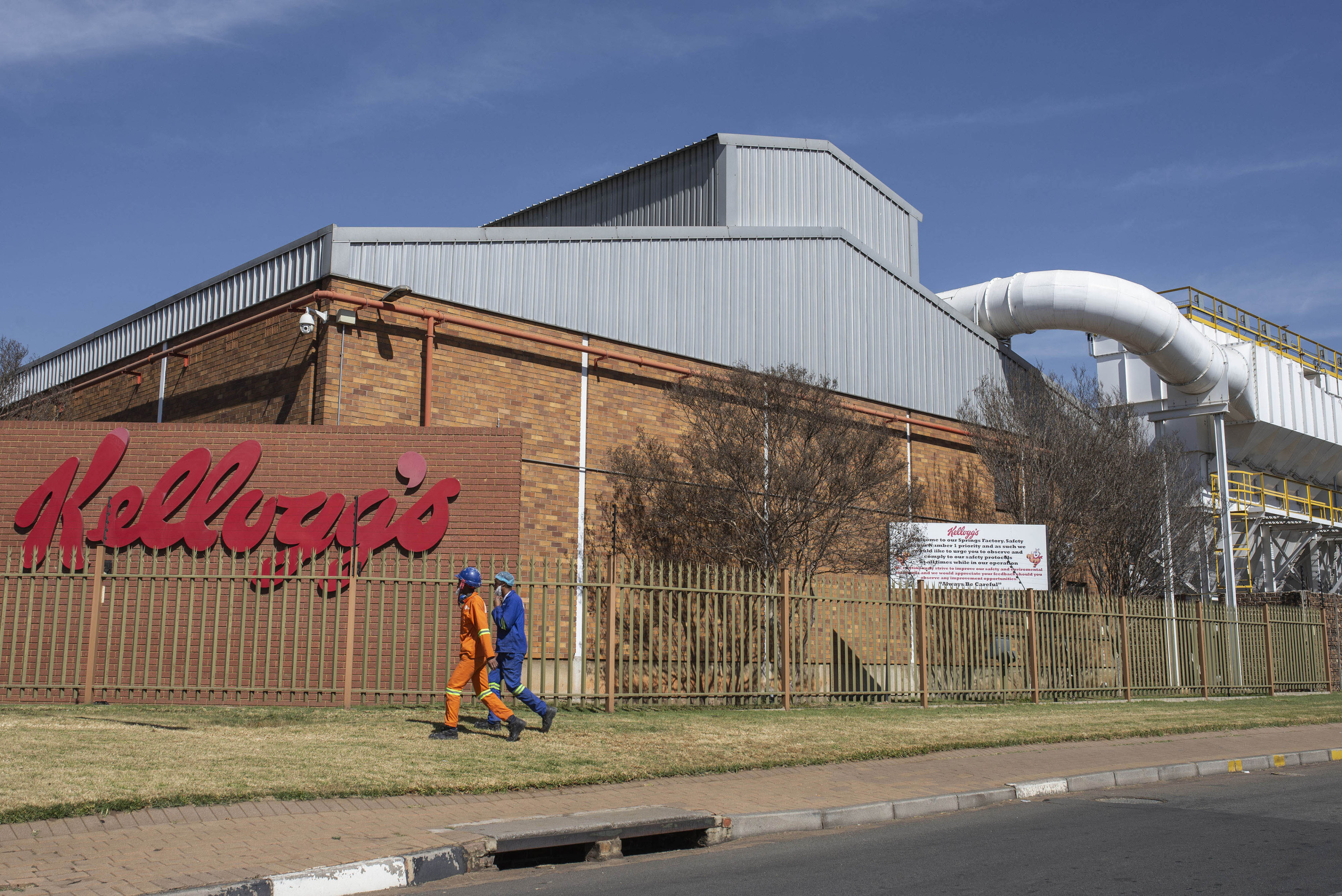 31 July 2018: Workers are seen walking outside the Kellogg's factory in Springs.