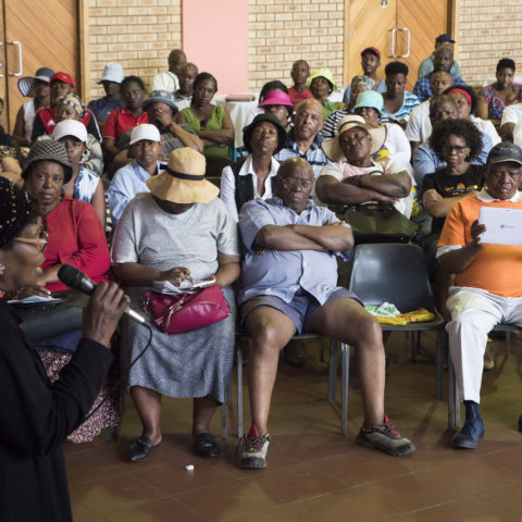 18 September 2018: Rose Nkosi, president of SASTA addresses people gathered at the Diepkloof Welfare Centre during a meeting held by the South African Spaza and Tuckshop Association.