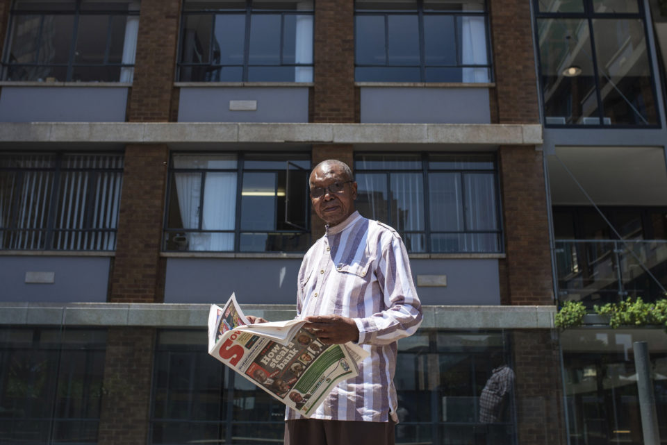 12 October 2018: Veteran journalist and anti-apartheid activist Joe Thloloe reading a daily paper in Braamfontein. His coverage of labour issues, especially in the 1980s, was closely linked to the growth of the black labour movement.