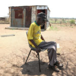 21 October 2013: Joseph Mampye in front of his shack near the Wallmansthal military base where residents were forcibly evicted from in the 1950's. A claim for the land was lodged with the government in 1996. (Photograph by Vathiswa Ruselo/Gallo images)