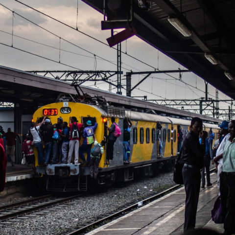 15 November 2018: Commuters are often forced to ride outside the carriages of the trains because they are filled to capacity during peak hours.
