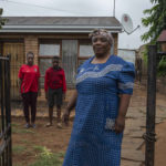 29 November 2018: (Right to left) Mary Mwale with her grandson Lesedi Chombo and daughter Patience Chombo outside their home in Katlehong.