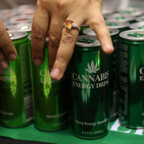 13 December 2018: Expo-goers reach out energy drinks, made from cannabis, on display at the opening of the four-day Cannabis Expo in Pretoria. (Photograph by Siphiwe Sibeko/Reuters)