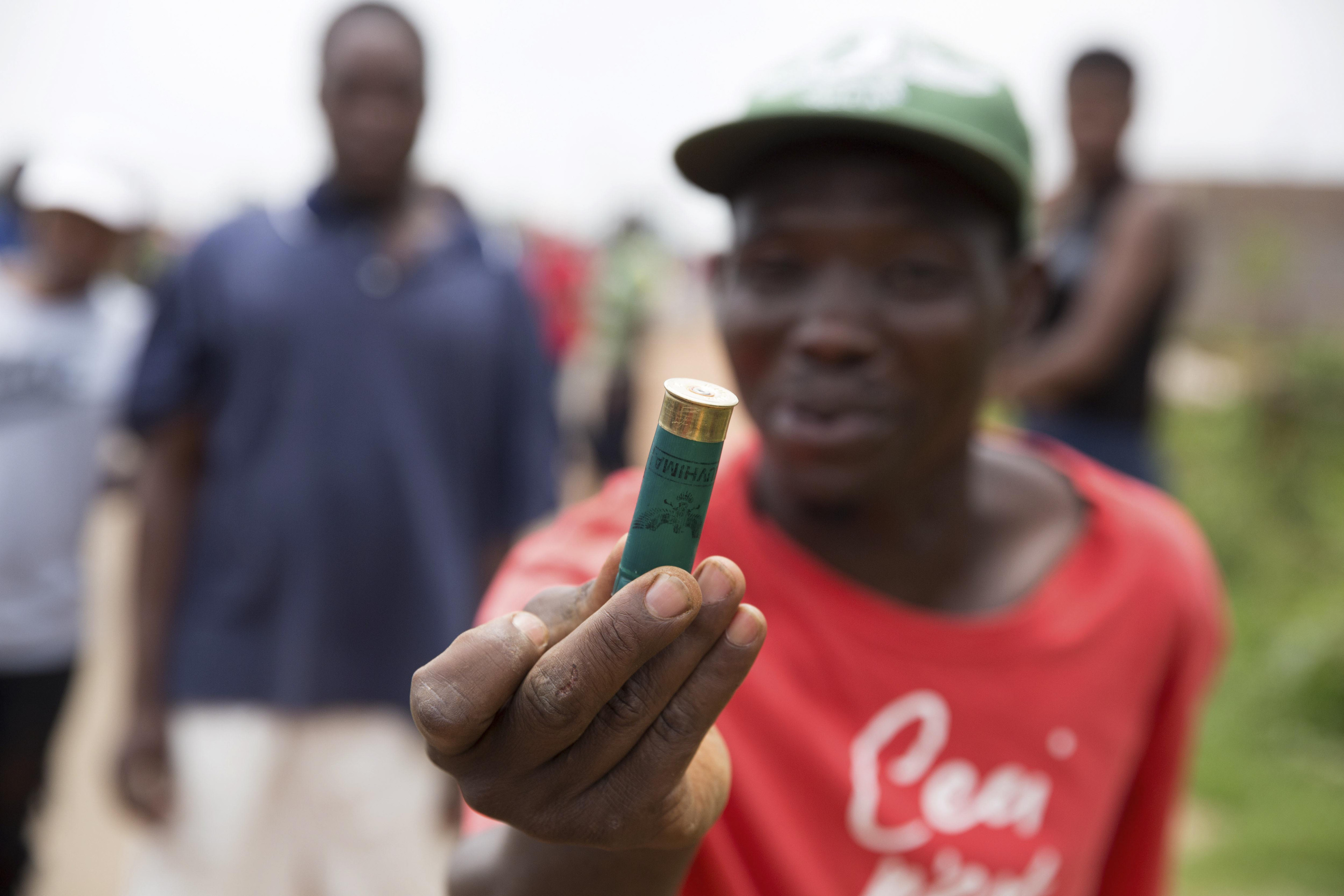 8 February 2019: A land occupier shows the cartridge of a rubber bullet he says Ekurhuleni metro police officers fired during an operation to evict them from land in Barcelona.