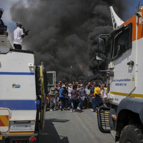 3 April 2019: A heavy police contingent looks on as Alexandra residents shut the township down in protest.