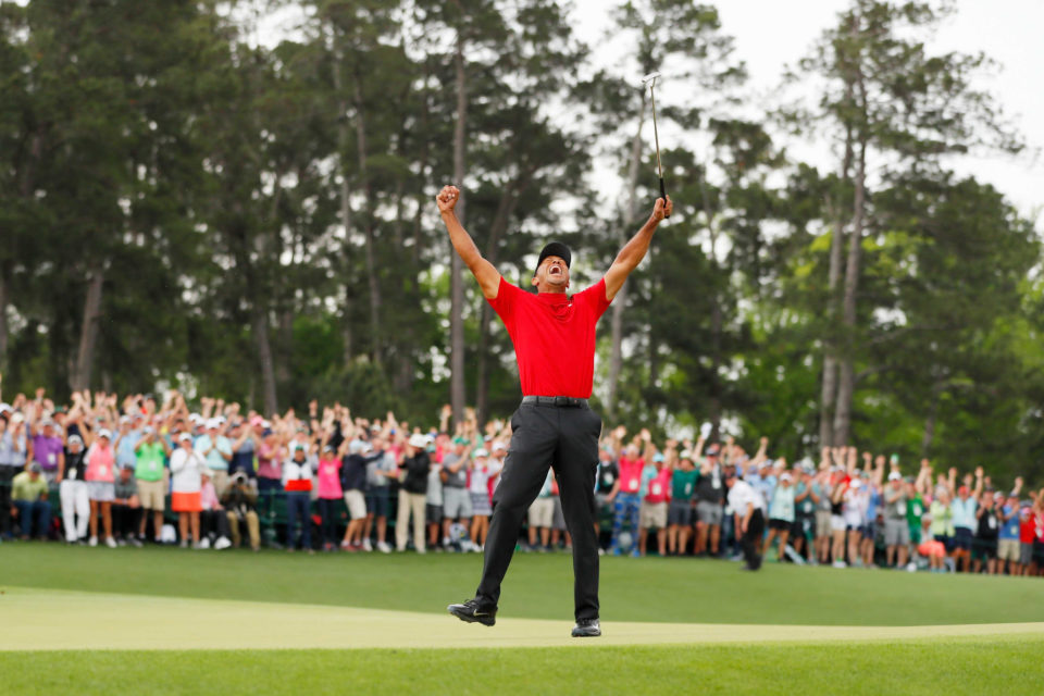 14 April 2019: Tiger Woods is jubilant after making his putt on the 18th green to win The Masters at Augusta National Golf Club in Augusta, Georgia. (Photograph by Kevin C Cox/Getty Images)