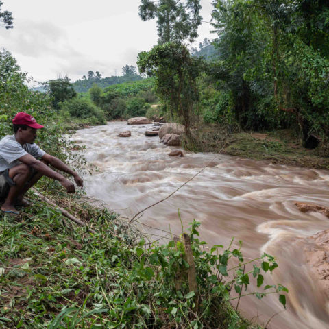 24 April 2019: Scelo Mtshali, 35, at the Umhlatuzana River, which burst its banks and flooded his shack in the nearby eKukhanyeni settlement. The water destroyed Mtshali's construction tools, which he uses to make a living doing building jobs.