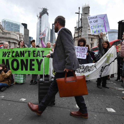 25 April 2019: Environmental campaigners from the Extinction Rebellion group block the junction at Bank tube station as part of their ongoing actions and protests in London, England. (Photograph by Leon Neal/Getty Images)